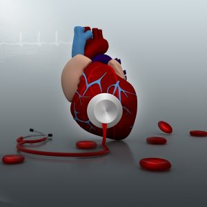 Stethoscope on a heart in medical background