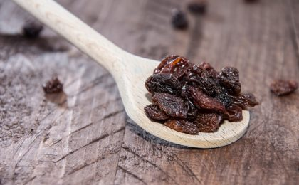 Raisins on a wooden spoon