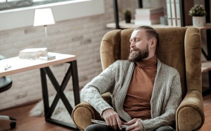 Tired psychologist having a little nap after hard-working day