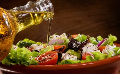 Vegetable salad with olive oil pouring