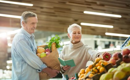 Senior Couple Grocery Shopping at Farmers Market