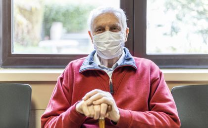 elderly man in a hospital with respirator