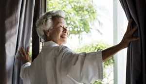 Gray Haired woman at window