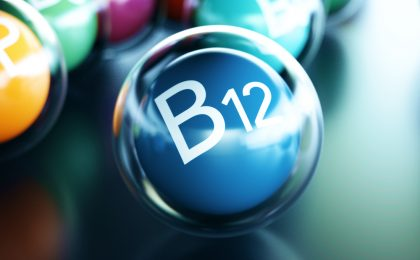 Vitamin B12, on black cue ball
